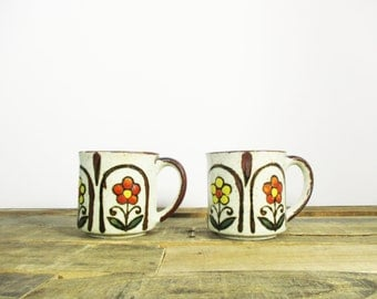 Pair of Retro Stoneware  Coffee Mugs for your office kitchen or home coffee bar. 1970's stoneware mugs feature a floral boho pattern.