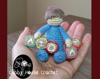 Crochet Pattern. Sitting Toddler AIDAN with building blocks.