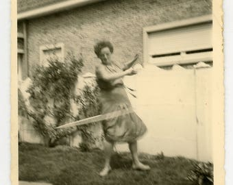 Vintage photo 'Hula' vernacular photography snapshot hulla hoop lady, in the garden, movement, play, fun, motion, exercise