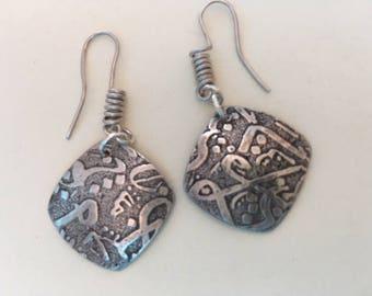 """Sterling silver """"ancient script"""" dangle earrings."""