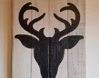 Rustic, handmade wall hanging with deer head silhouette