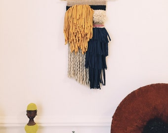 Blue and yellow wall weaving
