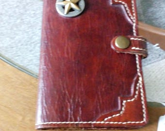100% Leather Note Book Cover with suede lining.