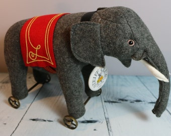 Steiff collectors club 1997 limited edition Grey wheeled elephant with box and certificate