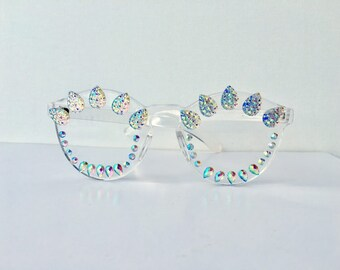 Clear glasses with iridescent gems