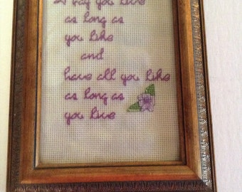 Framed cross stitch saying
