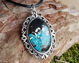 Beautiful necklace with REAL flower in the Interior and gold particles black, turquoise, gold, necklace