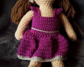 Crochet handmade yarn doll or rag doll with purple dress