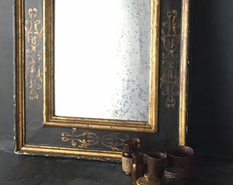 antique gold and black framed mirror