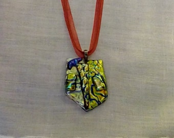 Glamorous gold, red and green dichroic glass pendant