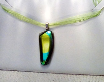 Red fused glass with gold and green swirled dichroic glass pendant