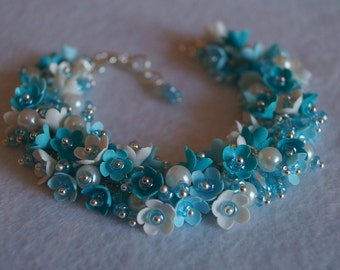 Bracelet with blue flowers from polymer clay