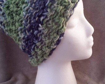Beanie hat.  Multi colored blues, greens and beige.