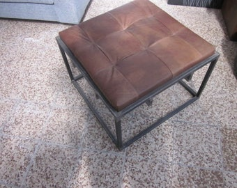 iron and leather pouf