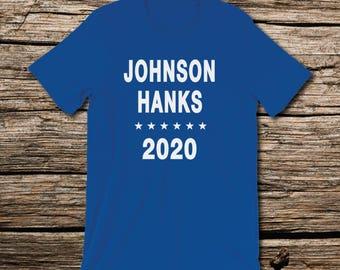 Johnson Hanks 2020, Because America Needs Us T-Shirt SNL Dwayne The Rock Johnson, Tom Hanks political humor Democrats Never Trump Anti Trump