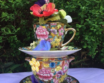 Mad Hatter tea party centerpiece Easter photo shoot props. tea cup & bowl arrangement. Alice in Wonderland. wedding table party