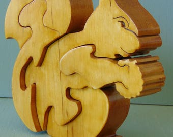 Handmade Squirrel Holding A Nut Solid Maple Hardwood 5 Piece Non Toxic Wooden Toy Puzzle.