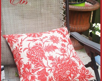Decorative  cushion, stamped flowers in red and beige