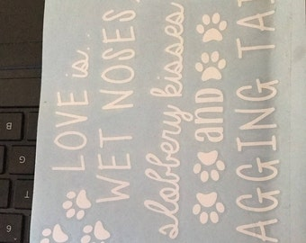 Love is wet noses, slobbery kisses, and wagging tails decal