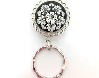 White Flower on Black with Silver Magnetic Eyeglass Holder