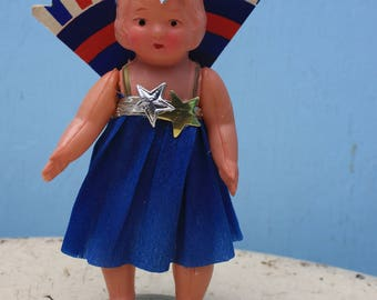 Vintage Fourth of July Celluloid Girl/Doll with Red White and Blue Cardboard Fan