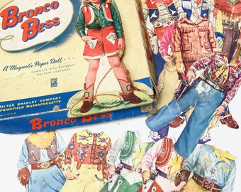 Vintage Bronco Bess Magnetic Paper Doll + Costumes (1950s)
