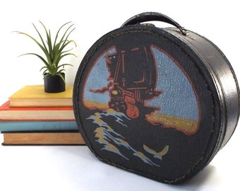 vintage 40s storage box pirate ship round train case painted scene black leather boat sailing water ocean tin handle luggage old antique