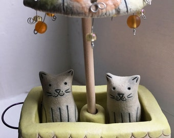 Cute Ceramic Sculpture of two White Cats Sitting in an Umbrella Cart