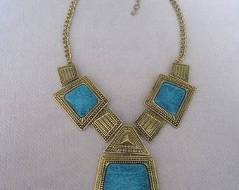 A LIttle Aztec Influence Antique Gold Trapezoid Shaped n Turquoise Inset Medallion Necklace