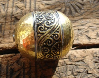 Moroccan  tarnished   large gold colour shiny ornate hand hammered barrel bead