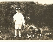 """Vintage Photo """"Kitty's Watching"""" Toys Pull-Along Horse Cart Wire-Haired Terrier Dog Little Girl Purse Kitty In The Grass Found Photo"""