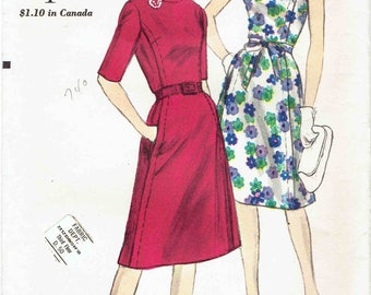 60s Vogue Dress Pattern 5645. Oval Neckline, Back Button, Sleeveless or Elbow Length Sleeves, Bow Tie Belt, Pockets. Size 18 Bust 38 in.