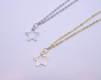 Gold star necklace. Silver star necklace. Tiny open star. Christmas Gift. Winter jewelry.