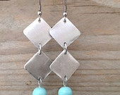 dangle metal and glass earrings baby blue