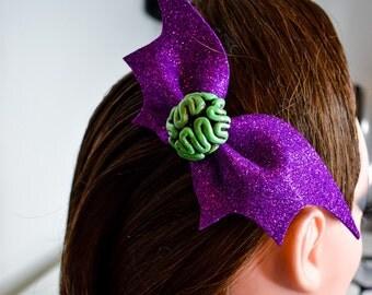 Brain and glitter bat wings bow hairclip