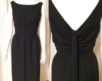 Beautiful vintage little black dress with hand beaded front and bow tie back