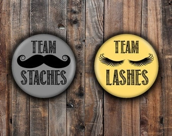Lashes or Staches gender reveal pins.  Gray and Yellow.