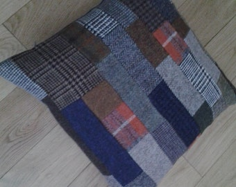 "Harris Tweed Cushion.  Lovely patchwork of Harris Tweed. Back is a good tweed but not Harris Tweed. Size is 17"" × 17"". has Zip closing."