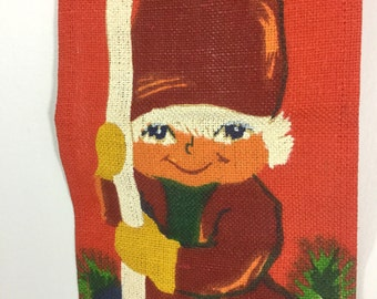 Vintage Christmas Elf Wall Hanging - Painted Burlap Banner with Brass Bell and Red Bow - Red and Green Elf with Candle - Scandinavian Xmas