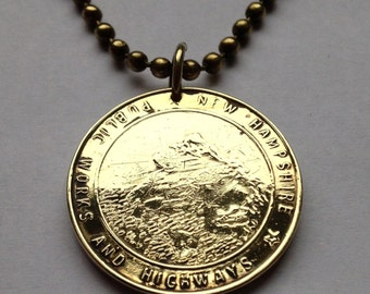 New Hampshire Public Works & Highways Toll Road token coin pendant necklace commuter transit White Mountains Concord Franconia n001638