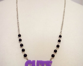 """Cute"" creepy purple adorned of black pearl necklaces"