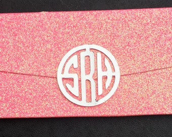 Monogram logo and glittery chocolate wrapper.