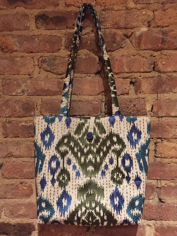 Roomy Tote bag with pockets and button/loop closure.  Beautiful fabric with embroidered detail