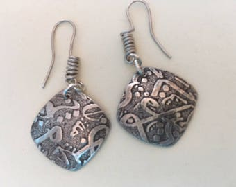 "Sterling silver ""ancient script"" dangle earrings."