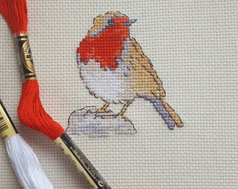 Red red cross stitched robin
