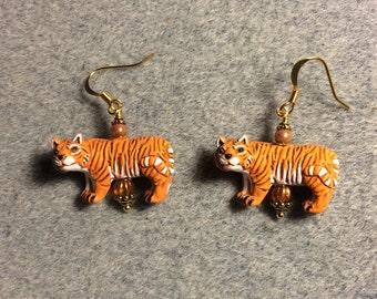 Orange striped ceramic tiger bead earrings adorned with orange Czech glass beads.