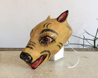 Funny animal wooden head. Mexican art
