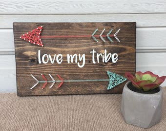 Hand-painted sign with string art arrows: love my tribe