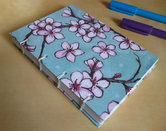 Hand bound notebook or bullet journal, A6 cherry blossom print blank Coptic stitch sketchbook or travel journal