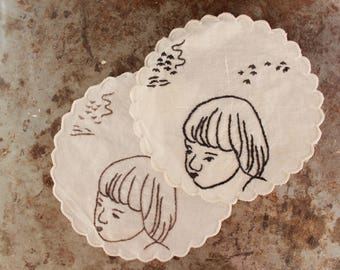 Embroidered vintage doilies